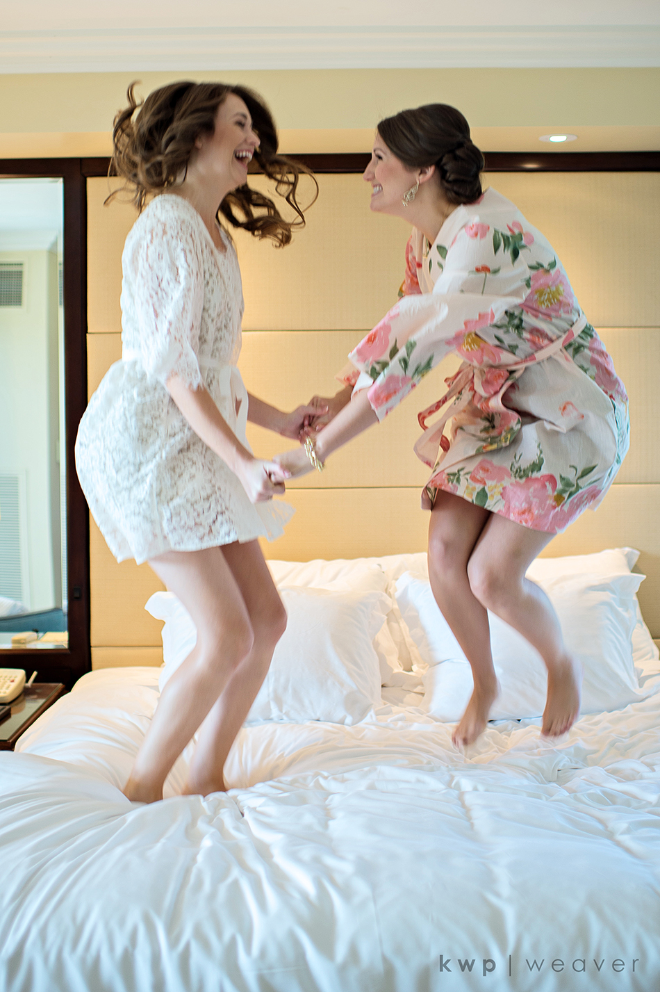 Sisters jumping on bed