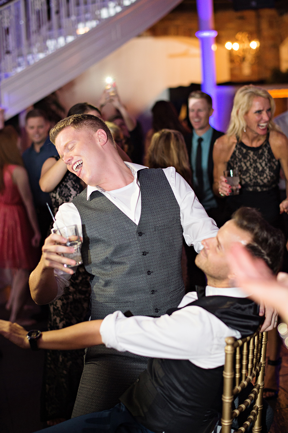 grooms dancing reception