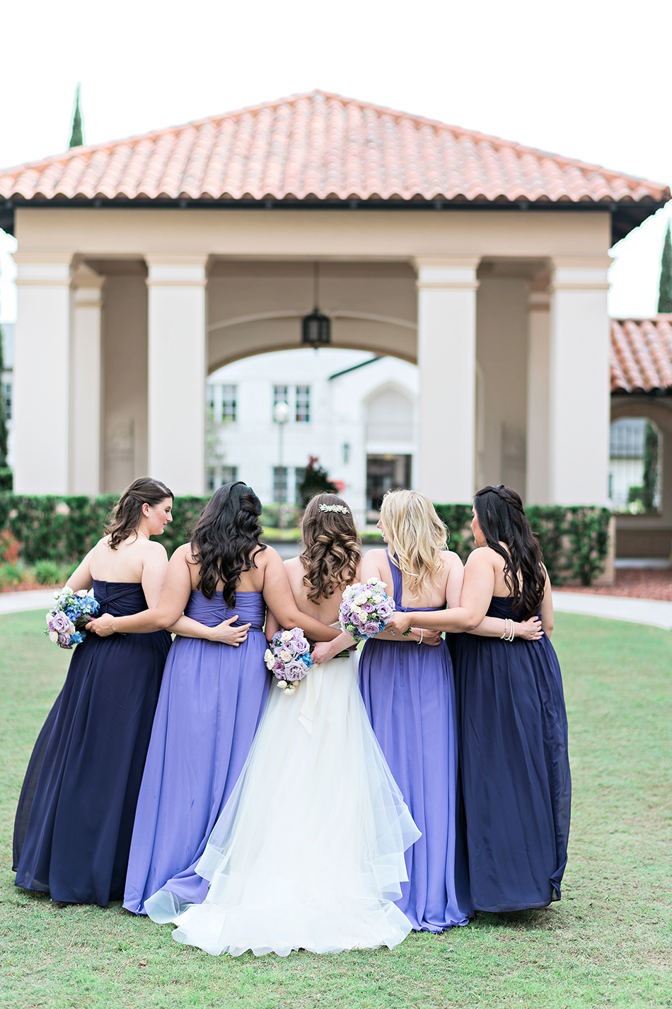 lavender and purple bridesmaid gowns