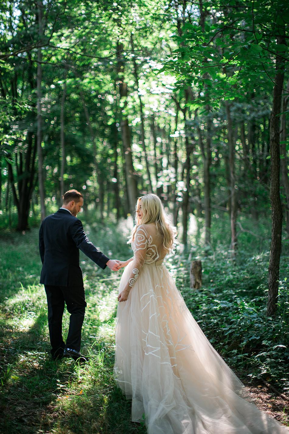 Bohemian bride wearing a Jim Hjelm by Hayley Paige wedding gown at La Esposita Bonita in Varysburg, NY