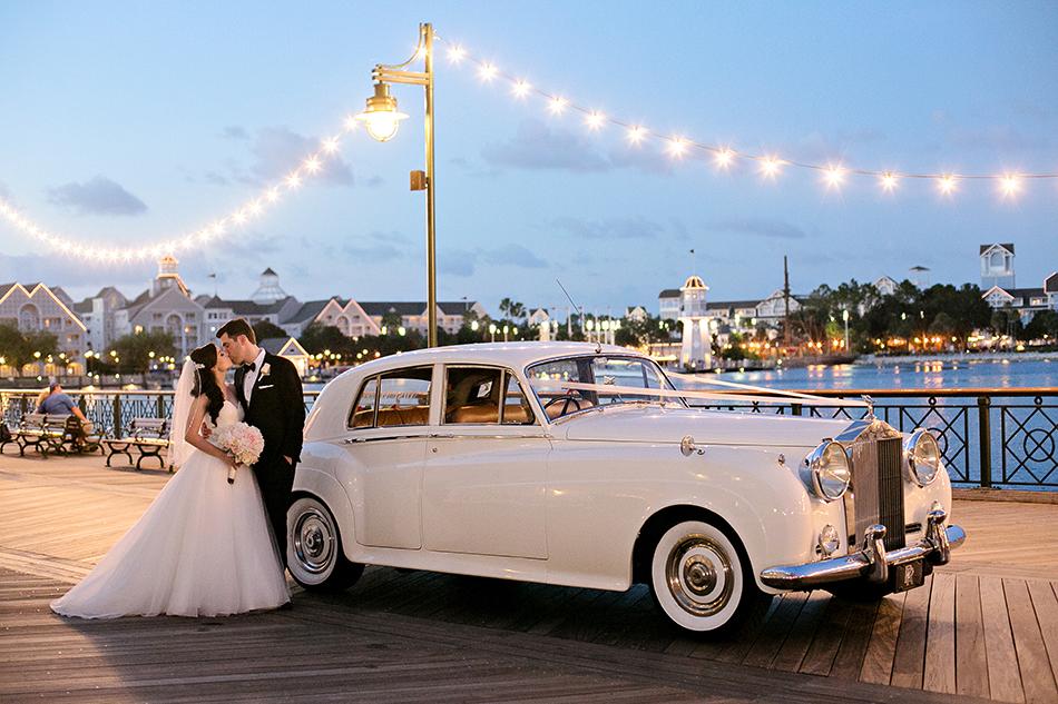 Disney's Boardwalk Resort at dusk - Bride and groom on the Boardwalk in a Rolls Royce