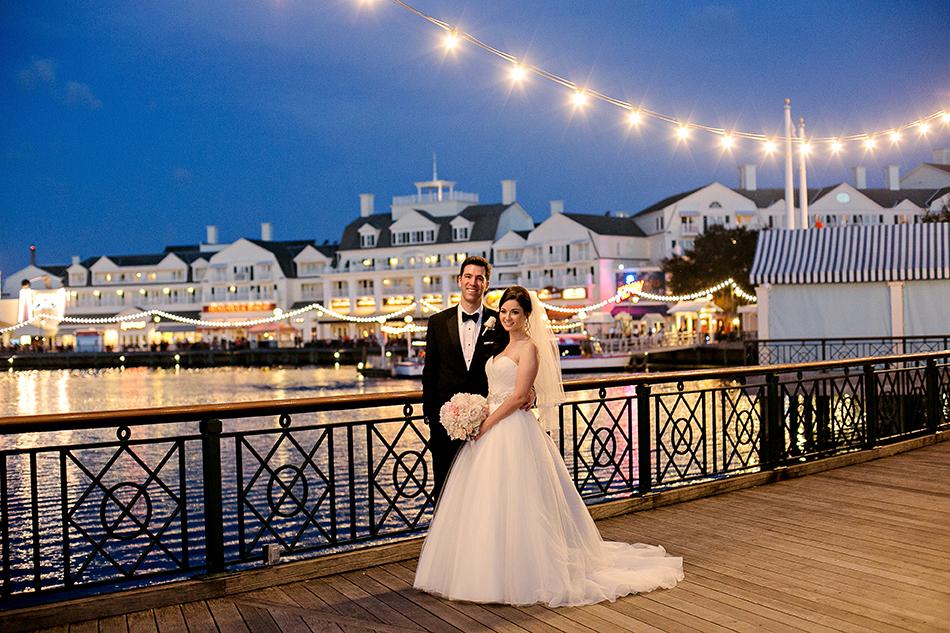Disney's Boardwalk Resort at dusk - Bride and groom on the Boardwalk