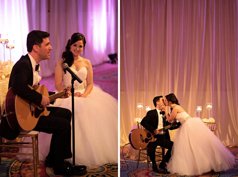 Groom serenading bride at wedding reception