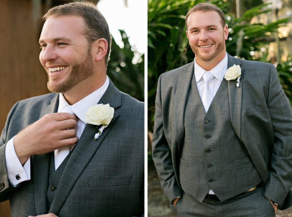 stylish groom poses for wedding day