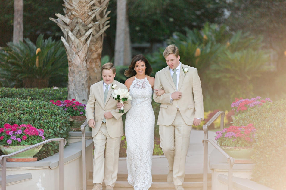 sons walking bride down aisle