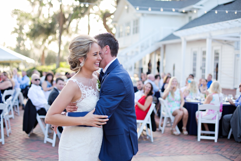 Laughing and hugging during first dance
