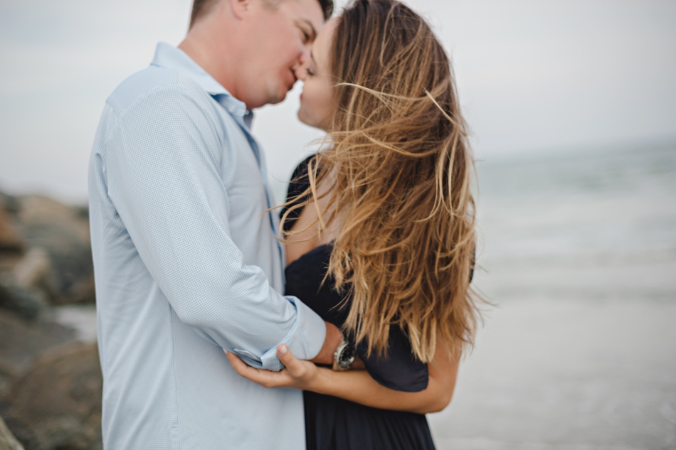 windy beach engagement