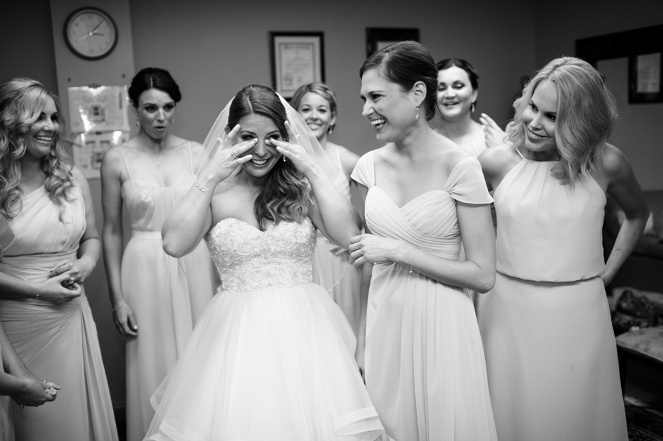 Bride crying with bridesmaids