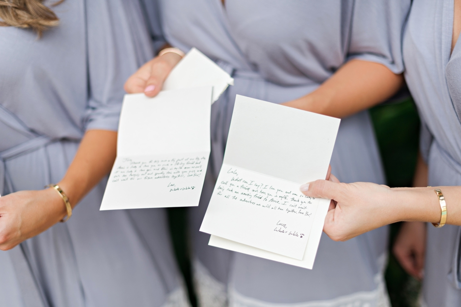 groom writes notes to bridesmaids
