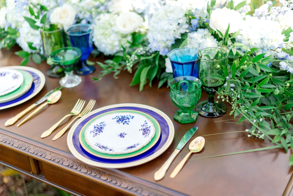 vintage table setting with gold flatware